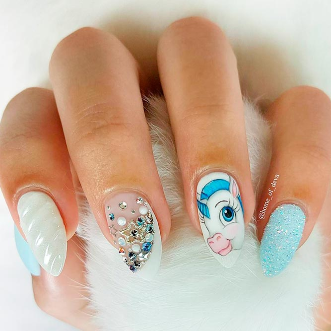 Love Unicorn? Check out our unicorn nail designs post for the best nail arts. You will sruely fall in love with these nail art designs. #unicorn #nails #nailart #naildesign